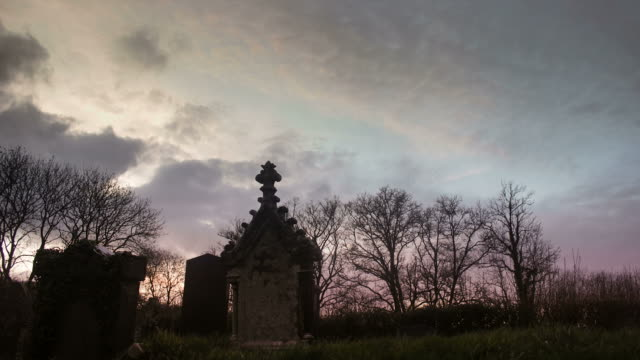 Timelapse of graveyard at sunset. video