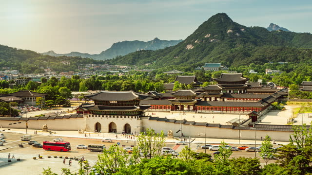 Time-lapse of Gwanghwamun Square and Nanshan mountain Time-lapse of Gwanghwamun Square and Nanshan mountain from day to night, Seoul, South Korea gwanghwamun gate stock videos & royalty-free footage