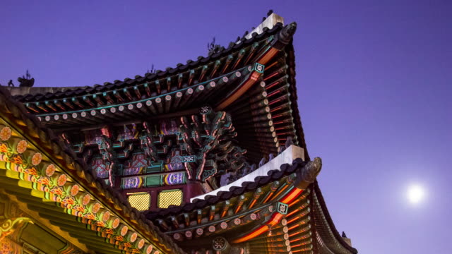 Timelapse of gyeongbokgung roof with moon Timelapse of gyeongbokgung Nightview, South Korea. korean culture stock videos & royalty-free footage