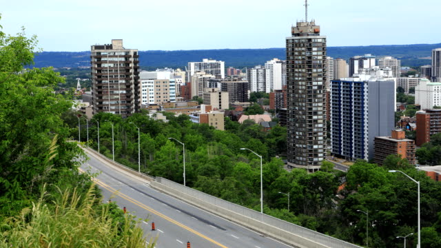Timelapse of Hamilton, Canada expressway with skyline behind A Timelapse of Hamilton, Canada expressway with skyline behind ontario canada stock videos & royalty-free footage