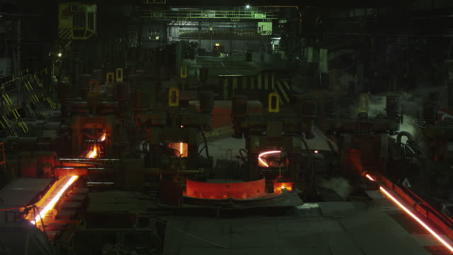 Timelapse of Heavy Industry Machines Processing Melted Burning Hot Metal. Rough Industrial Environment. Timelapse of Heavy Industry Machines Processing Melted Burning Hot Metal. Rough Industrial Environment. Shot on RED Cinema Camera in 4K (UHD). steel mill stock videos & royalty-free footage
