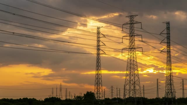 4K Timelapse of high voltage post.High-voltage tower at sunset time. Dolly shot