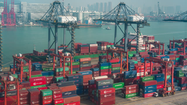 Timelapse of international port with Crane loading containers in import export business logistics at Hong Kong Timelapse of international port with Crane loading containers in import export business logistics at Hong Kong commercial dock stock videos & royalty-free footage