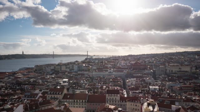 Timelapse of Lisbon and Tagus River Timelapse of Lisbon and Tagus River, on a cloudy day. ponte 25 de abril stock videos & royalty-free footage