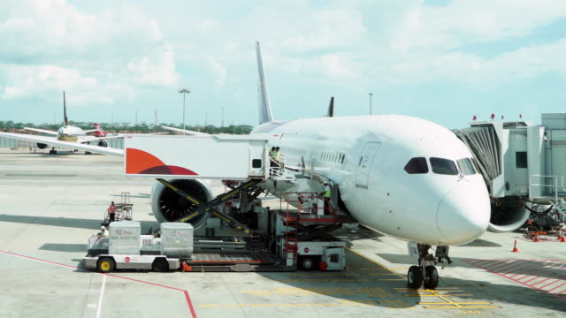 Timelapse of Loading cargo operation for commercial airplane video