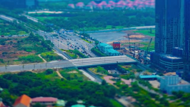 Ein Zeitraffer von Miniatur-Stau in der geschäftigen Stadt in Ho-Chi-Minh-Hochwinkel – Video