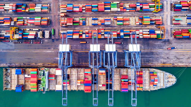 4k timelapse of modern industrial port with containers from top view or aerial view. it is an import and export cargo port where is a part of shipping dock. - nave mercantile video stock e b–roll
