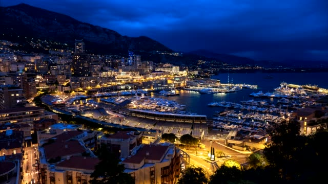 Timelapse of Monaco in the night Timelapse of Monaco Monte Carlo harbour and city skyline in the evening. Monaco Port night view with fast moving clouds monte carlo stock videos & royalty-free footage
