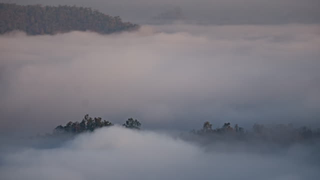 Time-lapse of mountain and moving mist at sunrise time video
