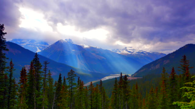 4K Time-Lapse of Moving Sun Rays over Mountain Ridges and Forest