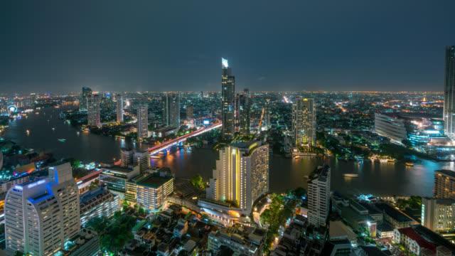 Timelapse of night scence of Bangkok skyline panorama and skyscraper in Bangkok city downtown at Chao Phraya River Bangkok Thailand.