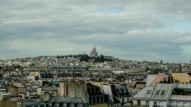 timelapse av paris panorama mulen dag - montmatre utsikt bildbanksvideor och videomaterial från bakom kulisserna