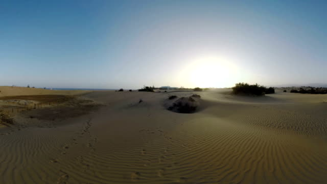 Timelapse of people in the distance walking on Maspalomas Dunes, Gran Canaria video