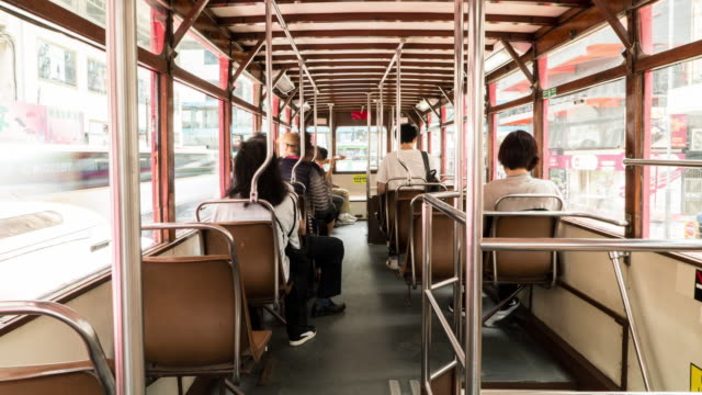 timelapse of people on the upper deck inside a double-decker tram. - wnętrze filmów i materiałów b-roll