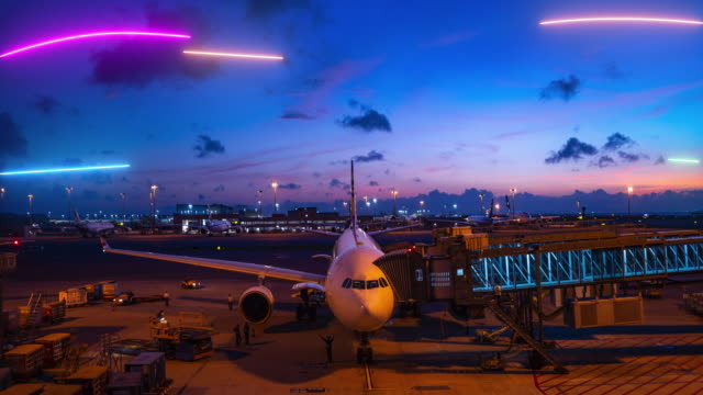 Time-Lapse of Plane at Airport. Air travel light painting, laser line. Night twilight at the Airport. The plane is preparing to travel. Air travel light painting, laser line. airport runway stock videos & royalty-free footage