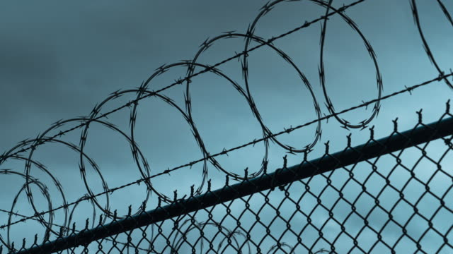 Time-Lapse of Prison Razor and Barb Wire Border Fence