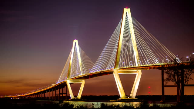 Timelapse of Ravenel Bridge in Charleston, SC Timelapse of Arthur Ravenel Jr. Bridge in Charleston, SC at twilight  with a ship passing through south carolina stock videos & royalty-free footage