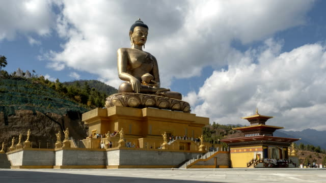 Timelapse of Seated Buddha Statue, Bhutan Timelapse of clouds over the 54 metre high bronze statue of the Great Buddha Dordenma overlooking the southern approach to the Thimphu valley in Bhutan, which was completed in 2015. statue stock videos & royalty-free footage