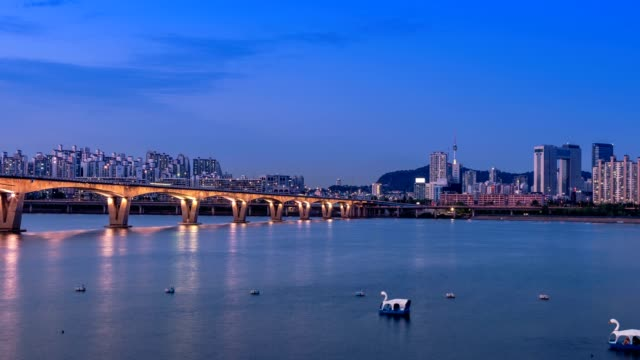 Timelapse of Seoul city and Seoul tower from day to night with a bridge over the han river, South Korea video