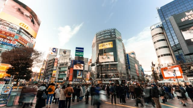 4K UHD time-lapse of Shibuya zebra crossing with crowded people and car traffic transport across intersection. Tokyo tourist attraction landmark, Japan tourism, or Asian city life concept