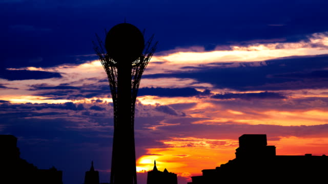 Timelapse of silhouette Bayterek tower in Astana capital of Kazakhstan on beautiful sunset Timelapse view of silhouette Bayterek tower in Astana capital of Kazakhstan on beautiful sunset kazakhstan stock videos & royalty-free footage
