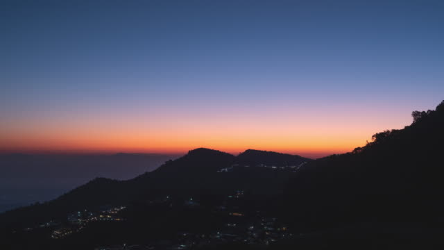 Timelapse of silhouette of mountain and city at sunrise time