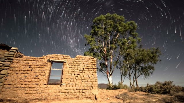 Timelapse of stars and night sky with abandoned building video