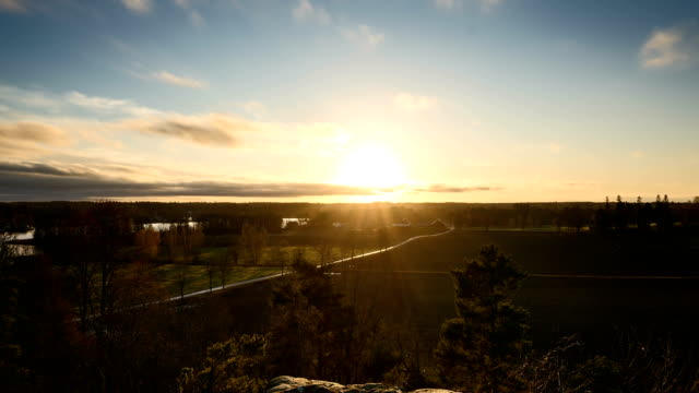 Timelapse of sunset in Sweden Timelapse of sunset in Sweden at evening. Beautiful nature and landscape. Calm and peaceful outdoors video. Great view from mountain. vinter stock videos & royalty-free footage