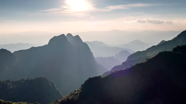 time-lapse of sunset on mountain peak at national park. doi luang chiang dao wildlife sanctuary - nord video stock e b–roll