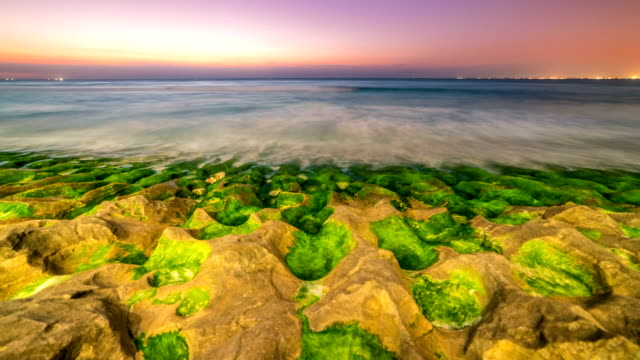 Timelapse of sunset on the beach of Balangan with frozen volcanic funnels on the island of Bali in Indonesia. video