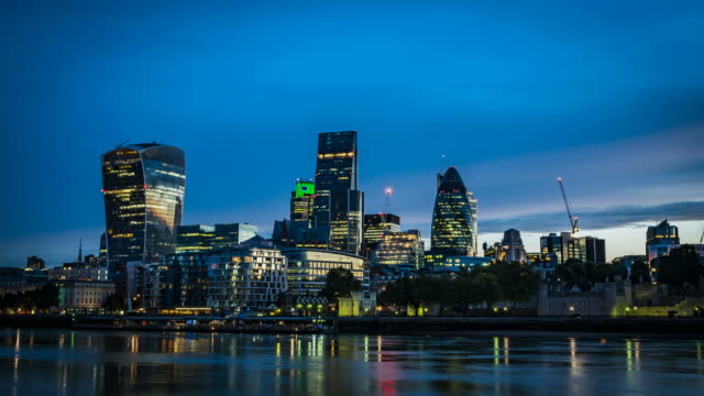 Timelapse of the Dawn over the city of London Time lapse of the sunrise over The City, one of the most important global financial center landmarks of the world on the North bank of river Thames in London, England dawn stock videos & royalty-free footage