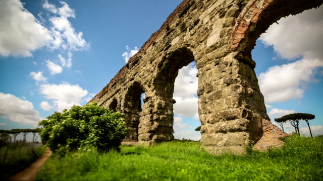Timelapse of the Roman Aqueduct at Parco degli Acquedotti Ancient roman aqueduct, ruins of the old water pipe built by the Romans. aqueduct stock videos & royalty-free footage