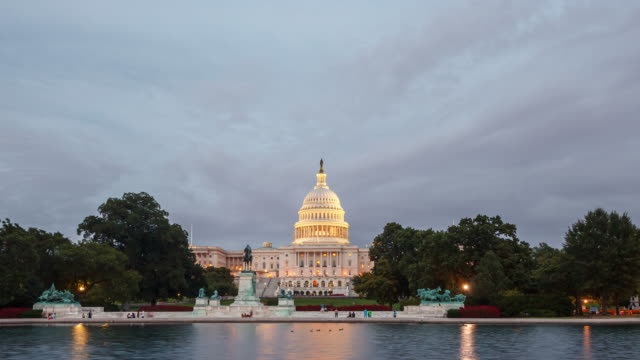 time-lapse of the united states capitol building in washington dc - stolice filmów i materiałów b-roll