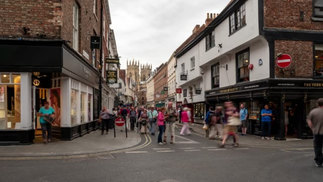 time-lapse of tourist pedestrian crowded shopping street in york yorkshire england uk. - england stock videos & royalty-free footage
