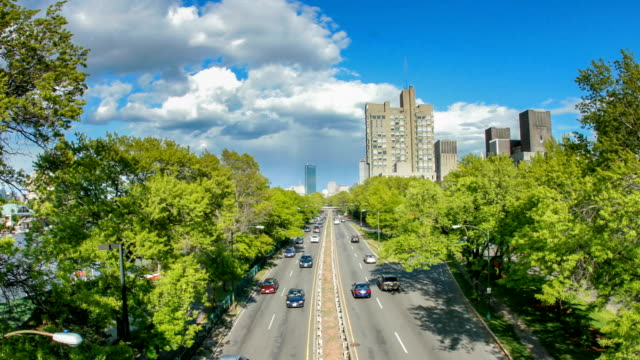 Timelapse of Traffic along Storrow Drive headed into Boston.  Blue Skies, Warm Summer Day.
