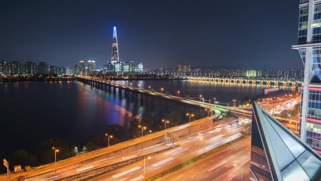 vídeos de stock e filmes b-roll de timelapse of traffic and architecture in seoul city ,south korea. - seul