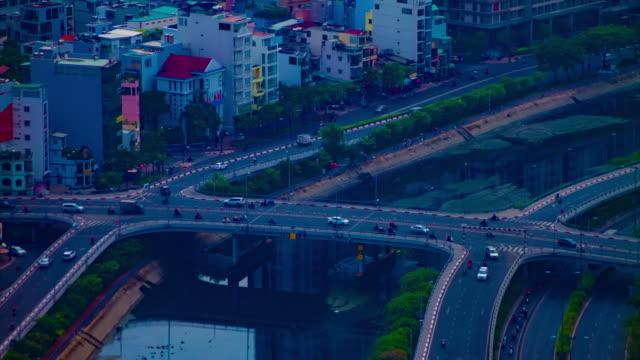 ein zeitraffer von stau in der geschäftigen stadt in ho-chi-minh-hochwinkel-langschuss - indochina stock-videos und b-roll-filmmaterial