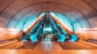 istock 4K UHD Time-lapse of unidentified people walking and using escalator at subway station. Public transportation, or commuter lifestyle concept 1142144313