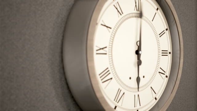 Timelapse of Vintage clock on dark wall. Timelapse of Vintage clock on dark wall. Two camera views, 60fps animation time zone stock videos & royalty-free footage