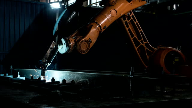 Timelapse of welding robot arm melt metal process at workshop. High Precision Modern Tools in Heavy Industry. Automatic work. Technology and Industrial Concept. Shot in 5K RAW video