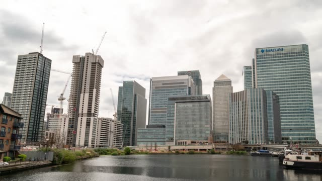 Time-lapse: Office building skylines skyscraper at London Canary Wharf England UK