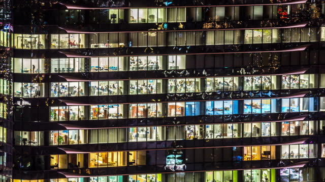 4K Time-lapse: Office Building Windows in Osaka at Night video