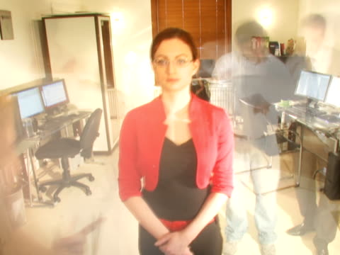 Timelapse office business Time lapse of female boss who stands and keeps calm in a crazy time rushed office. it professional stock videos & royalty-free footage