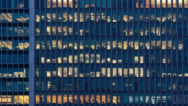 Time-lapse Office Window Night in London Canary Wharf England UK