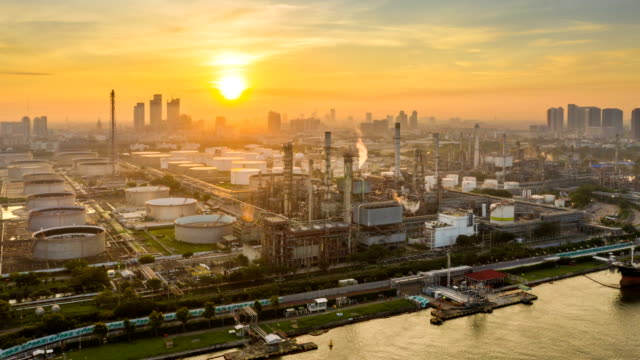 4K Timelapse or Hyperlapse of Aerial of industrial park with oil refinery and storage tank in Asia at Sunrise 4K Timelapse or Hyperlapse of Aerial of industrial park with oil refinery near river in Asia at Sunrise gas pipe stock videos & royalty-free footage