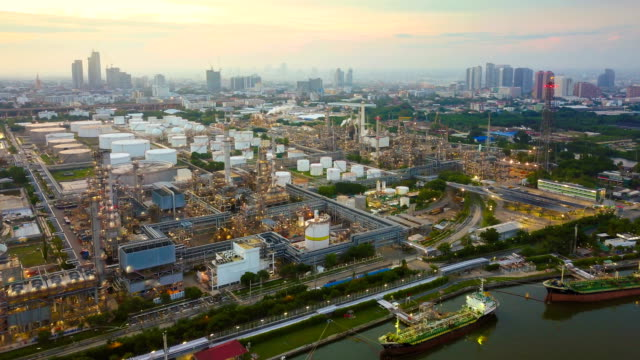 4k timelapse or hyperlapse of aerial of industrial park with oil refinery in asia - gaz filmów i materiałów b-roll