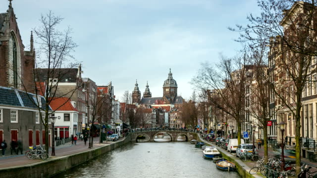 hd time-lapse panning: amsterdam canal with church of saint nicholas - dutch architecture stock videos & royalty-free footage