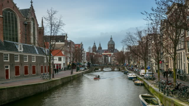 4K time-lapse panning: Amsterdam Canal with Church of Saint Nicholas video
