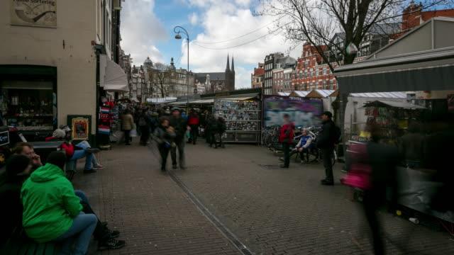 time-lapse panorering: stadens gågator shopping på blomstermarknaden amsterdam - blomstermarknad bildbanksvideor och videomaterial från bakom kulisserna
