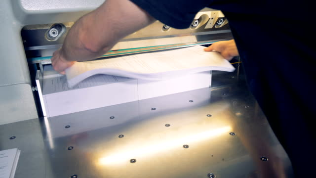 Timelapse. Paper cutting machine cut paper for pieces. video